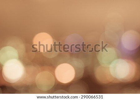 Blurred abstract background of dreamy pattern yellow gold candle night lights lantern bokeh in warm vintage color tone: Blurry golden night lantern light of festival, religious, and eid celebration - stock photo
