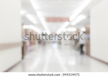 Blurred abstract background of hospital interior waiting hall/ corridor with patient in front of nurse station and OPD - out patient clinic department: Blurry view clinical indoor interior space - stock photo