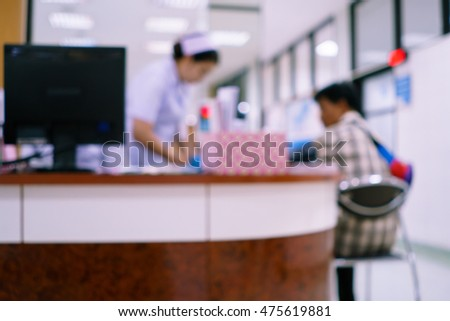 Blurred abstract background of hospital interior with nurses working.