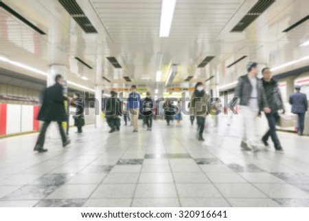 Blurred abstract background of many people on subway train, japan subway - stock photo