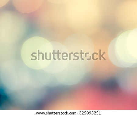 Blurred abstract background of night city life with candle lights bokeh in cool vintage cyan blue green sweet color tone: Blurry view of urban downtown nightlife cafe in retro style toned colour  - stock photo