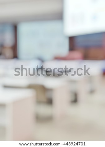 Blurred abstract background of people in meeting room . Blur view of attendance in conference hall with projectors.Defocus seminar at Business and Entrepreneurship Meeting with audience. - stock photo