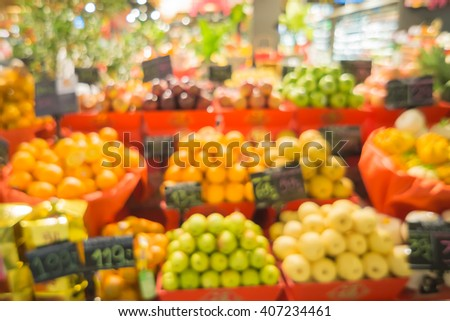 Blurred abstract background of people shopping in super market in vintage color tone,products on shelves in super market,Grapes, apples,pears,orange basket in the super market.can be used for display