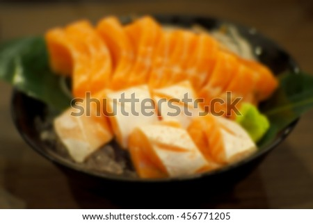 Blurred abstract background of salmon sashimi