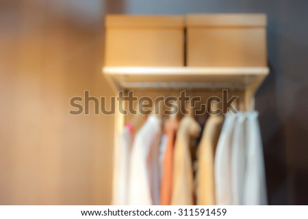 blurred abstract background of shirts hanging on rack - stock photo