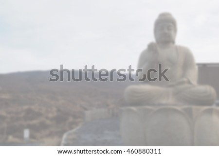 Blurred abstract background of Stone buddha statue