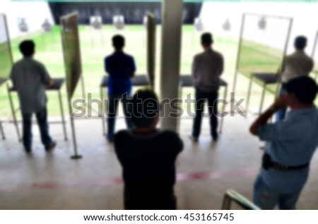 Blurred abstract background of The Gun Shooting
