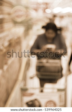 Blurred abstract background of Woman in the supermarket
