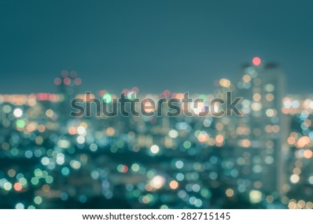 Blurred abstract background with light bokeh in cool vintage color tone of a scenic view of Bangkok cityscape at night   - stock photo
