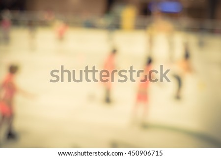 Blurred abstract motion background of parents and kids play indoor ice skating. Defocused of indoor ice skating with people on ice rink. Natural light from glass roof. Vintage. - stock photo