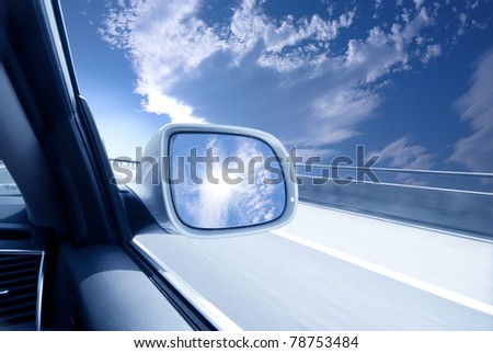 blurred action from car at high speed - stock photo