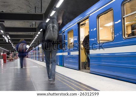 Blurred advancing people at the subway station - stock photo