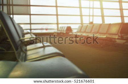 Blurred Airport at the Terminal with empty chair in Morning or Evening, Wait for Boarding
