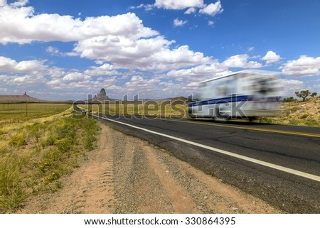 blurred ambulance on road through Monument Valley - stock photo