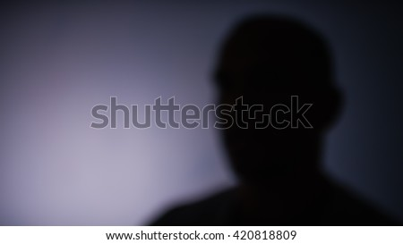 Blurred anonymous person with space for text