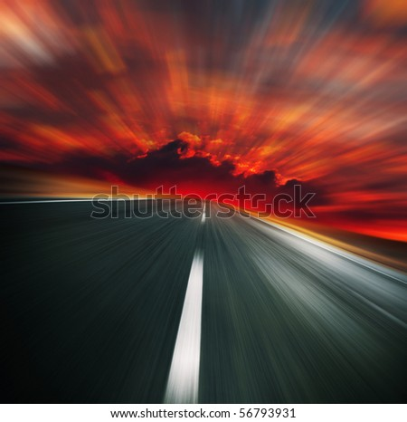Blurred asphalt road and red bloody blurred sky - stock photo