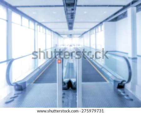 blurred Automatic elevator walk bridge - stock photo