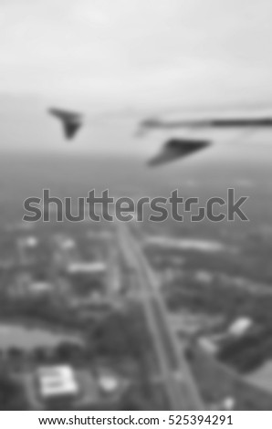Blurred  background abstract and can be illustration to article of Clouds and sky as seen through window of an aircraft