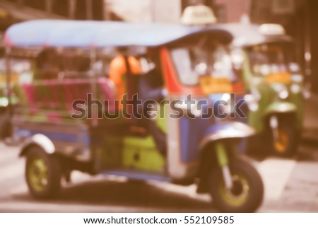 Blurred  background abstract and can be illustration to article of threewheeler classic motorised tuk-tuk taxi in Bangkok, Thailand