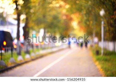 blurred background autumn street in the city - stock photo