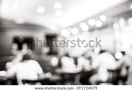 Blurred background black and white filter : Customer at restaurant blur background with bokeh. - stock photo