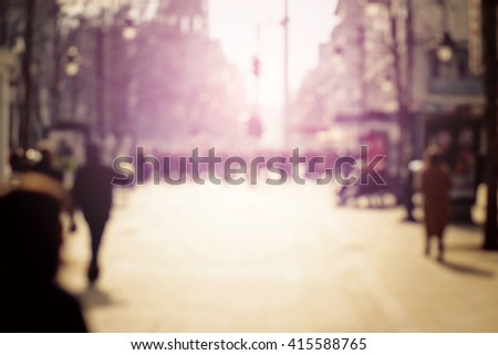 Blurred background. Blurred people walking through a city street. Toned photo. - stock photo
