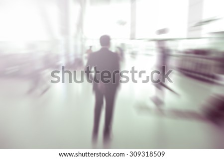 blurred background : business passenger in motion at airport terminal -  blur background concept - stock photo