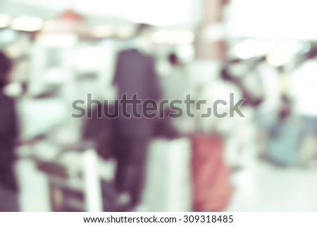 blurred background : businessman passenger waiting for flight at airport terminal -  blur vintage background with bokeh light. - stock photo