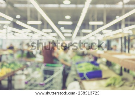 Blurred background : Customer shopping in Supermarket store, Vintage filter effect - stock photo