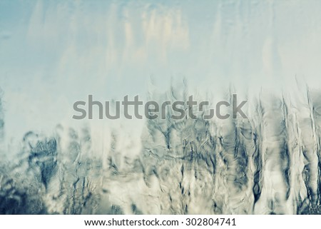 blurred background - forest through a window glass after rain