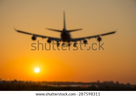 Blurred background from a landing plane at dusk. - stock photo