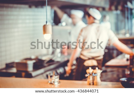 Blurred background : Group of chefs cooking in the kitchen - stock photo