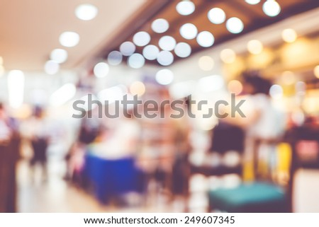Blurred background : Groups of customer queuing in front of restaurant. - stock photo