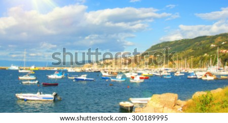 Blurred background. Image concept: sky, sea, ocean, mountain, wind, marina, port, parking ships and yachts. Place for text. Image advertising for holiday travel on the sea or the resort. Tourism - stock photo
