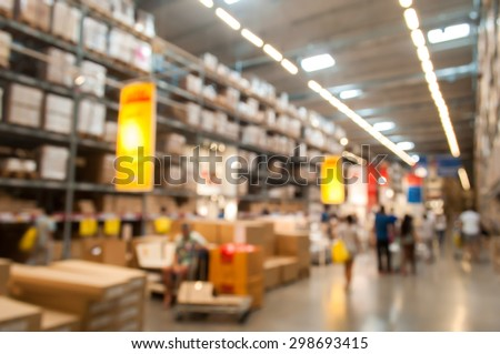 Blurred Background Image of Warehouse or Storehouse with many people - stock photo