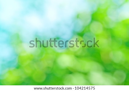 blurred background in natural spring green and blue colors, the bokeh effect - stock photo