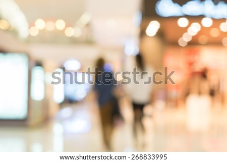 blurred background in shopping mall - stock photo