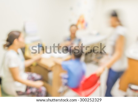 Blurred background : kid Patient and doctor in hospital .