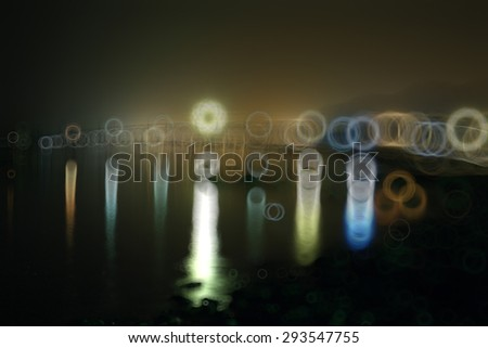 blurred background night city lights flashing drops