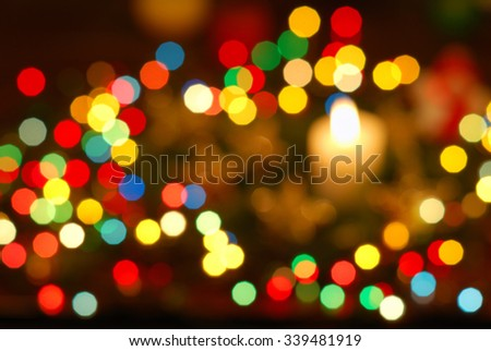 blurred background of a variety of colored lights and candles