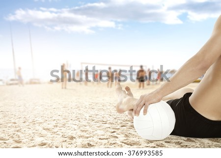 blurred background of beach volleyball and white ball on sand  - stock photo