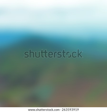 Blurred Background of Bright Sky on the Mountain Top in Daylight. Blurred Blue and Green of Nature Background. - stock photo