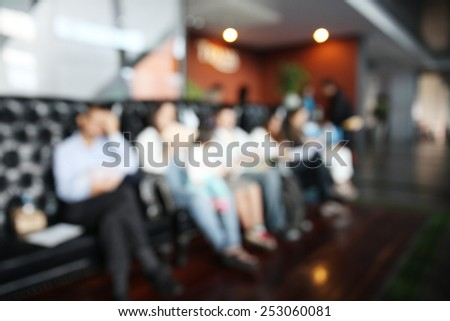 blurred background of business people waiting for job interview - stock photo