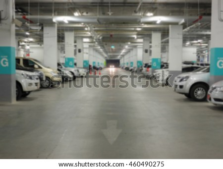 Blurred background of car in parking lot.