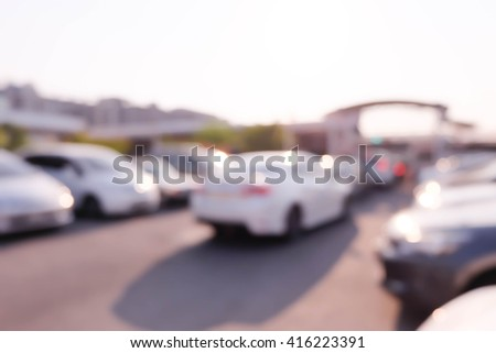 blurred background of car in parking lot,outdoor. - stock photo