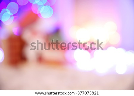 Blurred background of Christmas gift boxes and decoration on the soft carpet - stock photo