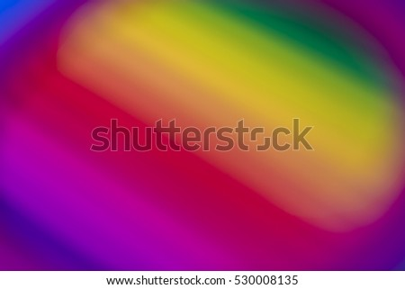 Blurred background of colour pencils creating a rainbow effect