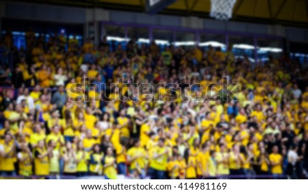 Blurred background of crowd of people in a basketball court - stock photo