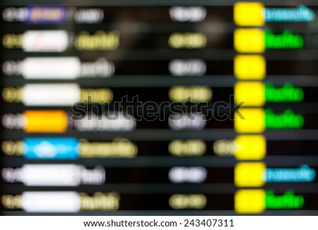 Blurred background of departure schedule board in airport. - stock photo