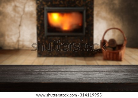 blurred background of fireplace and black wooden space